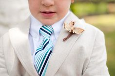 ring bearer with pinecone boutonniere