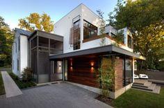 Ultra modern addition onto clapboard house