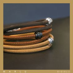 Bracciali in pelle sulle tonalità del marrone con inserto in acciaio e zirconi bianchi e neri. Collezione #ManClass.  Brown leather bracelets with steel insert and white and black zircons. #ManClass Collection