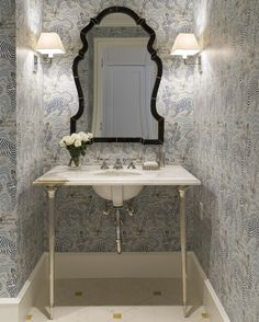 Bathroom with subtle animal print wallpaper and a marble sink, by J.K. Kling Associates