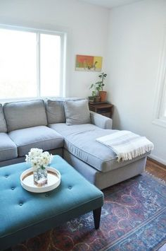 gray sectional blue upholstered ottoman