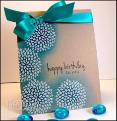 """By Vicki Dutcher. Stamp flowers on kraft & heat emboss with white powder. Sponge in area around flowers. Add sentiment & ribbon. So pretty! Stamps from """"Hello Sunshine"""" set by Gina K Designs."""