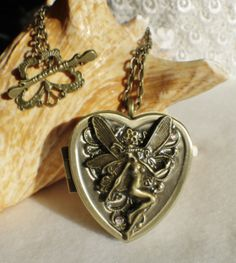 Music box locket, heart shaped locket with music box inside, in bronze with woodland fairy.