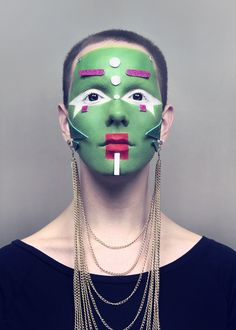 I love the geometric shapes and items glued to the face.