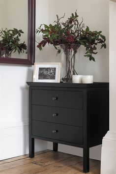 A simple black chest of drawers made from solid timber with a special matte Warm Black finish