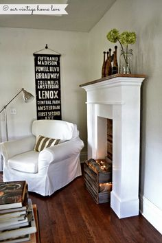 create a FAUX FIRE look ~ use a crate or make a box from barn wood or pallet wood, fill with burlap, logs and twinkle lights.  Plug in and voila!  For that extra touch, play crackling fire app.
