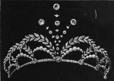 A diamond and pearl tiara, with a possible aigrette setting, by Edmond Lecas, 1889. Designed as a series of pearl arches, topped with diamond laurel leaf arches, flanking a central diamond spray motif.