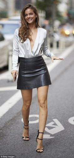 6ae6f57f765fa The Hungarian-born model added black stiletto heels and flashed a winning  smile