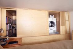 A 240-square foot, NYC studio apartment by Tim Seggerman, complete with mini-library, sleeping loft & washing machine. Talk about maximizing a small space!