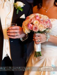 Rachel holding her pink & peach rose bouquet & Mike holding his scotch drink. Photo by: FRPhoto