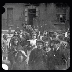 Tenement children in Henrietta Street Henrietta Street was one of Dublin city's earliest Georgian Streets. It dates from the and was the first project of Dublin's pre-eminent Georgian developer, Luke Gardiner. Dublin Street, Dublin City, Dublin Ireland, Ireland Travel, Old Pictures, Old Photos, Ireland People, Irish People, Ireland Homes