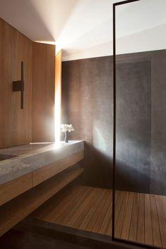 Lighting in Clements Design bathroom featuring wood, stone, metal