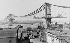 New York City: A view of the Manhattan Bridge, parallel to and a few blocks up from the Brooklyn Bridge, under construction in taken by Irving Underhill. Brooklyn Bridge, Manhattan Bridge, Manhattan New York, Manhattan Buildings, Lower Manhattan, New York Photos, Photos Du, Old Photos, Vintage Photos