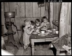 Vintage Christmas Photo ~ Christmas dinner, consisting of potatoes, cabbage and pie, in the home of Earl Pauley near Smithfield, IA, December 1936.  ---Wow, makes you appreciate everything you have. If your kids get upset because they don't get everything they want for Christmas, show them this photograph.
