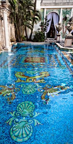 The opulent, gold-plated-mosaic pool at The Villa by Barton G. (formerly the Versace Mansion) on Ocean Drive in South Beach, Miami, Florida