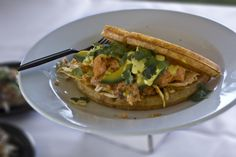 Salmon Waffle with Curry Slaw, fresh avacado and a saffron aioli!