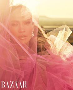 Jennifer Lopez poses in pink Oscar de la Renta gown and Bulgari earrings