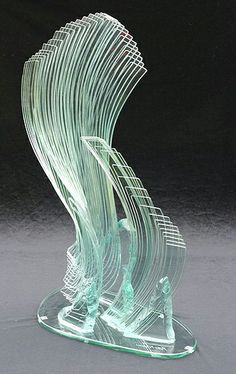 Newsome employs a sort of ray-like intensity by focusing on the overlapping transparencies of the media. The edges where the glass cuts off into air become patterns when pit against each other in natural light.