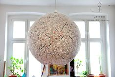 lampshade made of stripes of recycled newspapers
