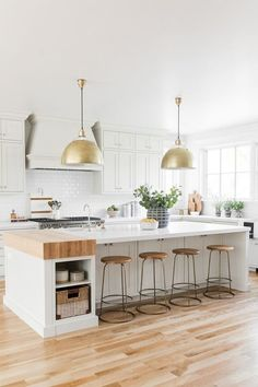 Beautiful all white kitchen with butcher block countertop on island and brass pendant lights - kitchen island ideas - kitchen lighting - kitchen remodel - kitchen design - kitchen ideas Farmhouse Kitchen Island, Kitchen Island Decor, Modern Farmhouse Kitchens, Home Decor Kitchen, Interior Design Kitchen, New Kitchen, Kitchen Designs, Kitchen Cabinets, Kitchen Countertops