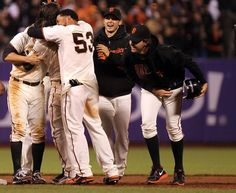 Cute! San Francisco Giants Melky Cabrera, and Ryan Theriot hug Brandon Crawford in celebration after he hitthe game winning RBI that scored Brandon Belt in the 9th inning giving the Giants a 3-2 win over the San Diego Tuesday, July 24, 2012