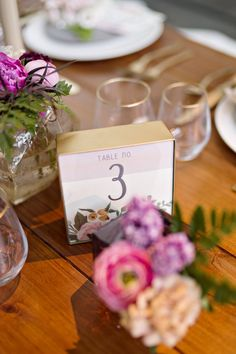 wedding reception table number idea; photo: Andie Freeman Photography