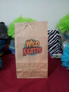 I ran brown paper bags through my printer and printed the wild kratts logo on it.