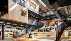 Airbnb's new Dublin headquarters, built inside an abandoned warehouse, is the first office the company has designed from scratch. The huge staircase at the center serves as a working and meeting area.