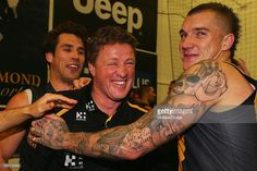 Tigers head coach Damien Hardwick celebrates the win with Dustin Martin of the Tigers during the round 20 AFL match between the Richmond…