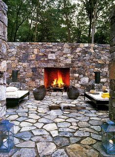 fireplace built into natural stone wall
