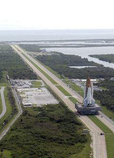 The crawler occupied two roads while transporting the Space Shuttle to its Launch Pad at Cape Kennedy, Florida.