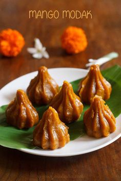 mango modak recipe with step by step photos. mango modak is a variation of modak recipes made with khoya or mawa. these modaks are prepared with fresh mango pulp, khoya (evaporated milk solids), sugar and flavored