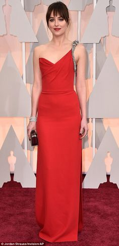 Keeping it simple but stunning: Dakota Johnson, who is presenting, teamed a red Saint Laurent gown with a ponytail