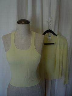 Yellow Chanel twin-set! see it here: https://www.etsy.com/ca/listing/192575417/chanel-yellow-twin-set?ref=related-5