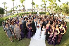 Cute photo of all guests/bridal party on the aisle at this Aruba beach wedding | Photography by Kenny Kim