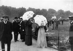 Suffragettes help the cause by carrying umbrellas with the slogan 'No Vote, no Tax' in London's Hyde Park.