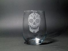 This beautifully decorated sugar skull is perfect for Dia de los Muertos, Halloween, and has been wildly popular for weddings. This design is easily customized with dates and names. See below for links to different types of glassware.  Contact us through the Etsy messaging system to create your perfect glassware. We love creating the glassware you will love for a lifetime.  Our glassware has added the perfect personalized touch for wedding parties, wedding favors, and bridal sets. We have…