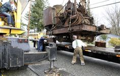 "Dec 4, 2012 - ""Crews from Imhoff Crane Service and Ballard Transfer Co. painstakingly settle a 1903 steam crane onto a flatbed trailer for transport from the Northwest Railway Museum in Snoqualmie to its new home, a bistro cafe [in Ballard] now under development by owner Jon Burgett."" (Snoqualmie Valley Record)"