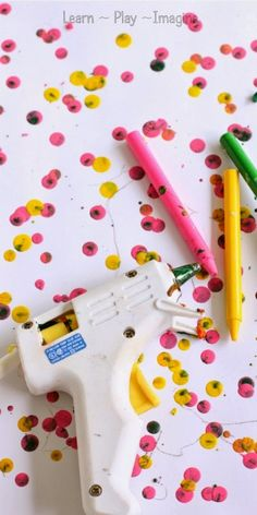 How to make gorgeous melted crayon art using a glue gun - seriously this is awesome!