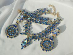 Vintage red carpet elegance with a grand parure featuring all Swarovski crystal.  Stones are vintage sapphire aurora borealis and current-market aurora borealis crystals intermixed to create an ocean of glittering blue.....gold plated
