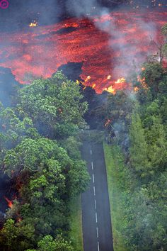 Aerial view taken 02 April 2007 of lava coming from the Piton de la Fournaise volcano burning vegetation and road in the Indian Ocean island of Reunion.