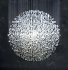 fb34c82ad4f by Stuart Haygarth - Optical -The Optical chandelier is created from over  4500 prescription spectacle lenses.