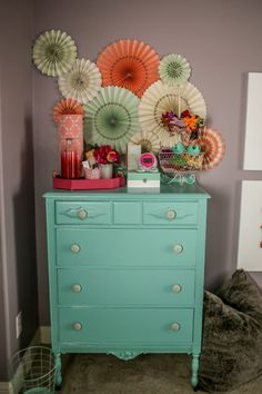 This painted aqua dresser is such a pop of color against the gray walls!