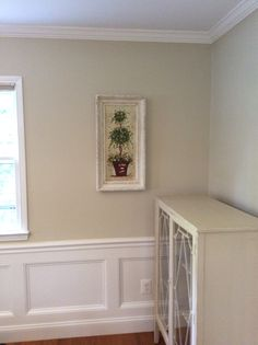 This used to be a bright red room when we moved in- thanks to painting and wainscoting by Pro Painters Plus in Vienna, Va- it's calming and beautiful! Wool Skein paint Sherwin Williams