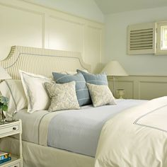 A soft blue and cream color scheme gives the master bedroom a tranquil vibe.