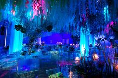 Suspended curled sheer blue, green, and coral fabric from the ceiling to create a seaweed look. - After party theme! haha