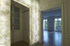 These beautiful back lit alabster walls are a bright focal point in this luxury Parisian apartment #AAE #Interiordesign