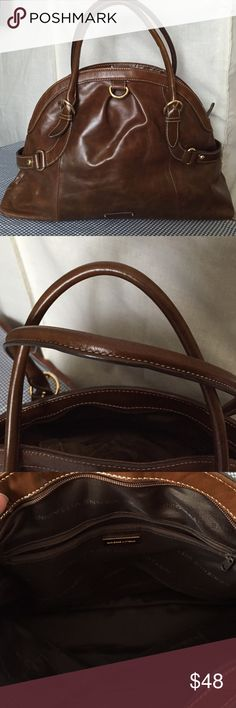 """🌸Sale 🌸 Adrienne Vittadini 🌸elegant leather bag 🌸BEAUTIFUL BAG!!!🌸This real leather satchel bag is in amazing shape! I have 12 brown bags, so just thinning out my collection. It is clean inside and out! It is large, 18"""" X 11"""" tall. 17"""" from the top of the strap to the bottom of the bag. I don't have a dust cover. One very slight scratch on it from storage. Price reflected. Perfect fall bag! Adrienne Vittadini Bags Satchels"""