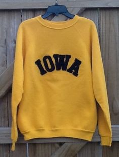Vintage collectible souvenir sweatshirt from the University of Iowa Hawkeyes. XL Heavyweight Discus Athlete Yellow with black Iowa raised lettering. Fun