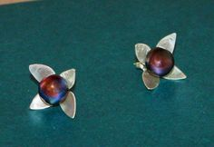 A personal favorite from my Etsy shop https://www.etsy.com/listing/123037804/sterling-dogwood-stud-earrings-with